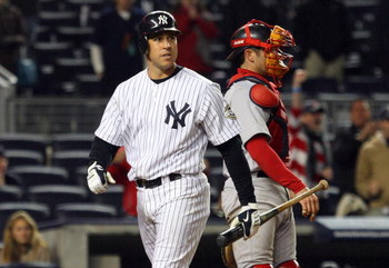 NEW YORK - MAY 04:  Mark Teixeira #25 of the New York Yankees walks back to the dugout after striking out in the ninth inning against the Boston Red Sox on May 4, 2009 at Yankee Stadium in the Bronx borough of New York City.  (Photo by Jim McIsaac/Getty I