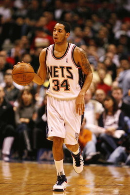 EAST RUTHERFORD, NJ - FEBRUARY 10:  Devin Harris #34 of the New Jersey Nets brings the ball up court against the San Antonio Spurs during their game on February 10, 2009 at The Izod Center in East Rutherford, New Jersey.  NOTE TO USER: User expressly ackn
