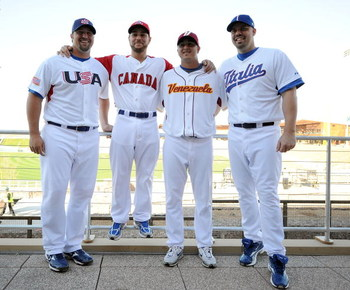 GLENDALE, AZ - FEBRUARY 21:  Jonathan Broxton #51, Russell Martin #55, Victor Garate #78 and Val Pascucci #71 of the Los Angeles Dodgers pose for a photo wearing their World Baseball team jerseys during photo day at Camelback Ranch on February 21, 2009 in