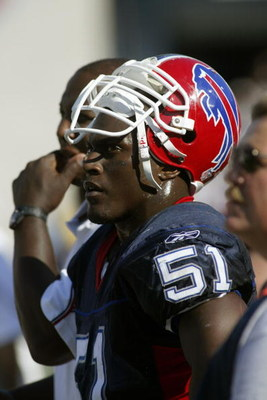 ORCHARD PARK, NY - SEPTEMBER 12:  Linebacker Takeo Spikes #51 of the Buffalo Bills watches the game against the Jacksonville Jaguars on September 12, 2004 at Ralph Wilson Stadium in Orchard Park, New York. The Jaguars won 13-10. (Photo by Rick Stewart/Get