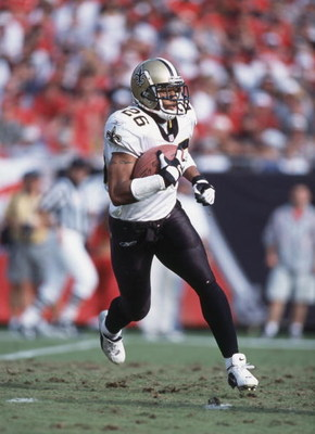 23 Dec 2001:  Running back Deuce McAllister #26 of the New Orleans Saints runs with the ball during the NFL game against the Tampa Bay Buccaneers at Raymond James Stadium in Tampa Bay, Florida. The Buccaneers defeated the Saints 48-21.  \ \ Mandatory Cred