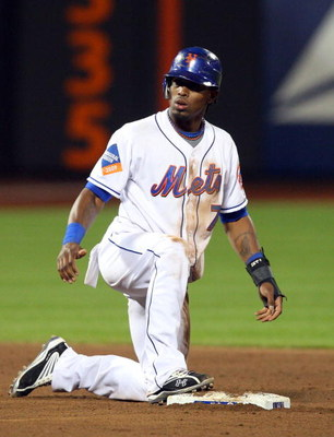 NEW YORK - MAY 12:  Jose Reyes #7 of the New York Mets is safe at second base against the Atlanta Braves on May 12, 2009 at Citi Field in the Flushing neighborhood of the Queens borough of New York City. The Mets defeated the Braves 4-3 in ten innings.  (