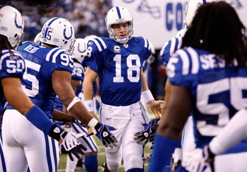 INDIANAPOLIS - DECEMBER 28:  Peyton Manning #18 of the Indianapolis Colts takes the field with teammates during player introductions prior to the first half of the game against the Tennessee Titans at Lucas Oil Stadium December 28, 2008 in Indianapolis, I