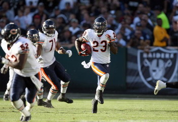 OAKLAND, CA - NOVEMBER 11: Devin Hester #23 of the Chicago Bears carries the kick off return against the Oakland Raiders during an NFL game on November 11, 2007 at McAfee Coliseum in Oakland, California. (Photo by Jed Jacobsohn/Getty Images)