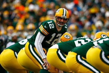 GREEN BAY, WI - DECEMBER 07:  Quarterback Aaron Rodgers #12 of the Green Bay Packers calls out a play against the Houston Texans during the first half at Lambeau Field on December 7, 2008 in Green Bay, Wisconsin. The Texans defeated the Packers 24-21.  (P