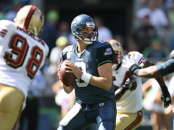 SEATTLE - SEPTEMBER 14:  Quarterback Matt Hasselbeck #8 of the Seattle Seahawks looks to pass against the San Francisco 49ers on September 14, 2008 at Qwest Field in Seattle Washington. The 49ers defeated the Seahawks 33-30 in overtime. (Photo by Otto Gre
