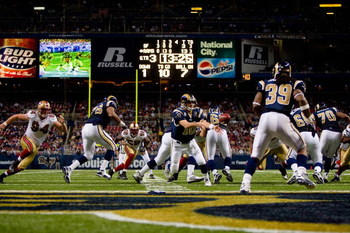 ST. LOUIS, MO - DECEMBER 21:  Marc Bulger #10 of the St. Louis Rams pitches the ball to Steven Jackson #39 during the game against the San Francisco 49ers at the Edward Jones Dome on December 21, 2008 in St. Louis, Missouri. The 49ers won 17-16. (Photo by