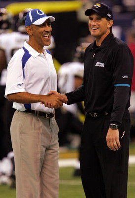 INDIANAPOLIS - SEPTEMBER 21:  (L-R) Head coach Troy Dungy of the Indianapolis Colts greets assistant coach, Mike Shula of the Jacksonville Jaguars on September 21, 2008 at Lucas Oil Stadium in Indianapolis, Indiana.  (Photo by Ronald Martinez/Getty Images