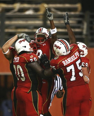 ORLANDO, FL - DECEMBER 29:  Wide receiver Darrius Heyward-Bey #8 of the Maryland Terrapins celebrates his touchdown catch with teammates Stephon Heyer #70 and Dane Randolph #75 in the second quarter against the Purdue Boilermakers in the Champs Sports Bow
