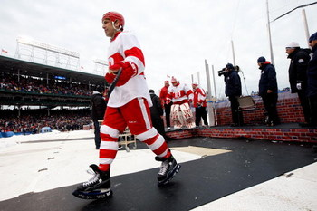 CHICAGO - JANUARY 01:  Chris Chelios #24 of the Detroit Red Wings walks back towards the dugout against the Chicago Blackhawks during the NHL Winter Classic at Wrigley Field on January 1, 2009 in Chicago, Illinois.  (Photo by Jamie Squire/Getty Images)
