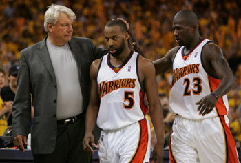 OAKLAND, CA - MAY 11:  Baron Davis #5 of the Golden State Warriors is congratulated by Head Coach Don Nelson and Jason Richardson #23 after defeating the Utah Jazz in Game Three of the Western Conference Semifinals during the 2007 NBA Playoffs at Oracle A