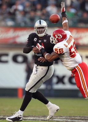 OAKLAND, CA - NOVEMBER 30: Quarterback  JaMarcus Russell #2 of the Oakland Raiders passes the ball against Derrick Johnson #56 of the Kansas City Chiefs during an NFL game on November 30, 2008 at the Oakland-Alameda County Coliseum in Oakland, California.