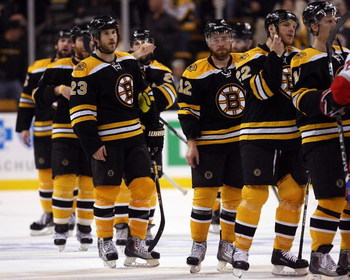 BOSTON - MAY 14:  The Boston Bruins line up to congratulate the Carolina Hurricanes after Game Seven of the Eastern Conference Semifinal Round of the 2009 Stanley Cup Playoffs on May 14, 2009 at the TD Banknorth Garden in Boston, Massachusetts. The Hurric