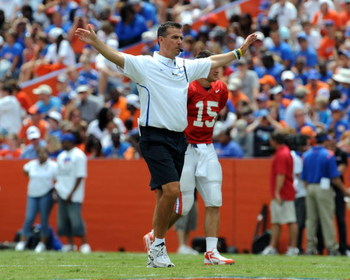 GAINESVILLE, FL - APRIL 18: Coach Urban Meyer of the University of Florida directs the spring football orange and blue game at Ben Hill Griffin Stadium April 18, 2009 in Gainesville, Florida.  (Photo by Al Messerschmidt/Getty Images)