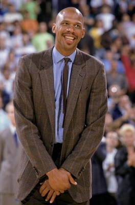 LOS ANGELES - 1989:  NBA Hall of Fame center Kareem Abdul-Jabbar smiles during his jersey retirement at the Great Western Forum in Los Angeles, California in 1989.  (Photo by: Stephen Dunn/Getty Images)