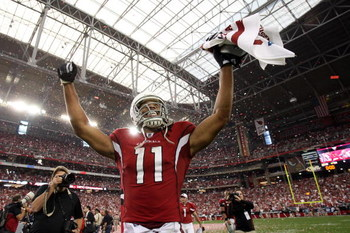 GLENDALE, AZ - JANUARY 18:  Wide receiver Larry Fitzgerald #11 of the Arizona Cardinals celebrates after winning the NFC championship game against the Philadelphia Eagles on January 18, 2009 at University of Phoenix Stadium in Glendale, Arizona. The Cardi