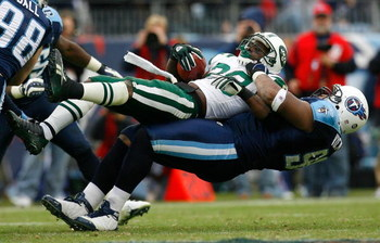 NASHVILLE, TN - NOVEMBER 23:  Kevin Vickerson #96 of the Tennessee Titans lifts and tackles running back Thomas Jones #20 of the New York Jets during the game at LP Field on November 23, 2008 in Nashville, Tennessee.  (Photo by Kevin C. Cox/Getty Images)