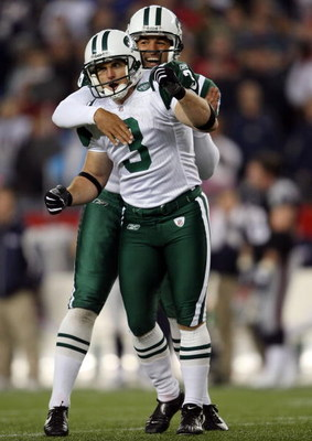 FOXBORO, MA - NOVEMBER 13:  Jay Feely #3 of the New York Jets is congratulated by teammate Reggie Hodges #6 after Feely kicked the game winning field goal in overtime against the New England Patriots on November 13, 2008 at Gillette Stadium in Foxboro, Ma