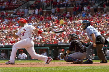 ST. LOUIS, MO - APRIL 23: Albert Pujols #5 of the St. Louis Cardinals hits an RBI single against the New York Mets on April 23, 2009 at Busch Stadium in St. Louis, Missouri. The Cardinals beat the Mets 12-8.  (Photo by Dilip Vishwanat/Getty Images)