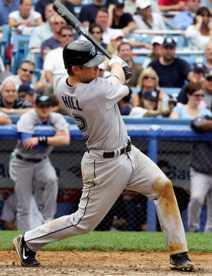 NEW YORK - JULY 19:  Aaron Hill #2 of the Toronto Blue Jays hits a RBI triple in the seventh inning against the New York Yankees during their game at Yankee Stadium on July 19, 2007 in the Bronx borough of New York City. The Jays defeated the Yankees 3-2.