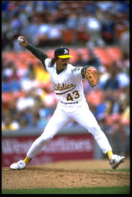 9 APR 1992:  OAKLAND A''S PITCHER DENNIS ECKERSLEY WINDS UP TO PITCH DURING THE A''S VERSUS TEXAS RANGERS GAME AT THE OAKLAND COLISEUM IN OAKLAND, CALIFORNIA.  MANDATORY CREDIT:  KEN LEVINE/ALLSPORT