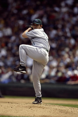 SEATTLE - JUNE 5:  Hideo Nomo #11 of the Tampa Bay Devil Rays pitches during the game with the Seattle Mariners on June 5 2005 at Safeco Field in Seattle Washington. The Mariners won 6-5.   (Photo by Otto Greule Jr/Getty Images) 