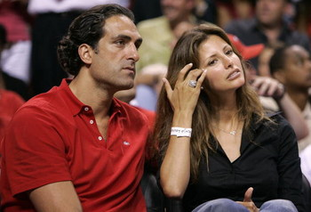 MIAMI - JUNE 6:  Former NBA player Rony Seikaly and Sports Illustrated Swim Suit cover model Elsa Benitez attend Game Seven of the Eastern Conference Finals between the Detroit Pistons and the Miami Heat during the 2005 NBA Playoffs June 6, 2005 at the Am