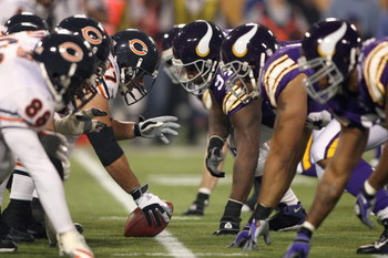 MINNEAPOLIS - NOVEMBER 30:  Center Josh Beekman #67 of the Chicago Bears gets ready to hike the ball during the game against the Minnesota Vikings at the Metrodome on November 30, 2008 in Minneapolis, Minnesota. (Photo by Jonathan Ferrey/Getty Images)