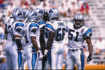 1 Oct 1995:  Linebacker Sam Mills #51 of the Carolina Panthers looks to the sideline for the defensive alignment call while standing in the team huddle in between plays during the Panthers 20-13 loss to the Tampa Bay Buccaneers at Memorial Stadium in Clem