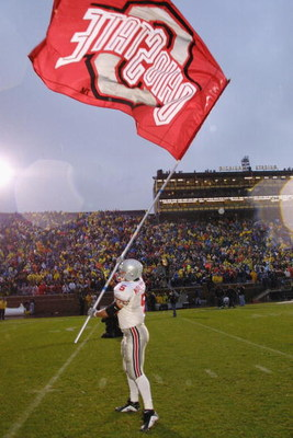ANN ARBOR, MI - NOVEMBER 24:  Runing back Sam Maldonaldo #5 of the Ohio State Buckeyes waves a school banner after winning the Big Ten Conference football game against the Michigan Wolverines on November 24, 2001 at Michigan Stadium in Ann Arbor, Michigan