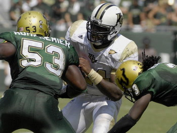 TAMPA, FL - OCTOBER 13:  Running back Kevin Smith #24 of the University of Central Florida Knights rushes uppield against the South Florida Bulls on October 13, 2007 at Raymond James Stadium in Tampa, Florida. The fifth-ranked Bulls won 64-12.  (Photo by