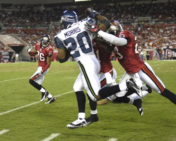 TAMPA, FL - OCTOBER 19: Running back Maurice Morris #20 of the Seattle Seahawks rushes upfield against the Tampa Bay Buccaneers at Raymond James Stadium on October 19, 2008 in Tampa, Florida. (Photo by Al Messerschmidt/Getty Images)