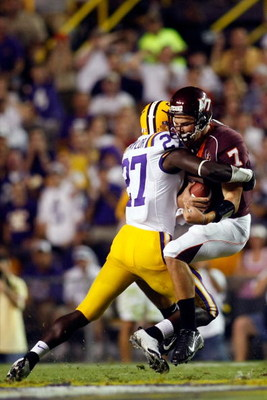 BATON ROUGE, LA - SEPTEMBER 08:  Quarterback Sean Glennon #7 of Virginia Tech is sacked by Curtis Taylor #27 of Louisiana State University in the first quarter on September 8, 2007 at Tiger Stadium in Baton Rouge, Louisiana.  (Photo by Chris Graythen/Gett