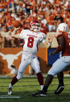 AUSTIN, TX - SEPTEMBER 27: Quarterback Tyler Wilson #8 of the Arkansas Razorbacks throws against Texas Longhorns in the fourth quarter on September 27, 2008 at Darrell K Royal-Texas Memorial Stadium in Austin, Texas.  Texas won 52-10. (Photo by Brian Bahr