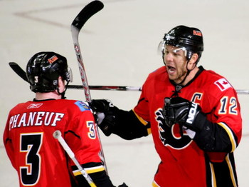 CALGARY, AB - APRIL 22: Jarome Iginla #12 and Dion Phaneuf #3 of the Calgary Flames celebrate Iginla's empty net goal to seal the win against the Chicago Blackhawks in Game Four of the Western Conference Quarterfinals of the 2009 Stanley Cup Playoffs on A