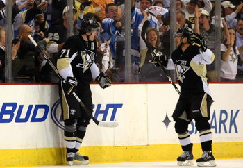 PITTSBURGH - MAY 18:  Evgeni Malkin #71 of the Pittsburgh Penguins celebrates his goal with Tyler Kennedy #48 against the Carolina Hurricanes during Game One of the Eastern Conference Championship Round of the 2009 Stanley Cup Playoffs on May 18, 2009 at