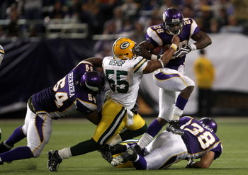 MINNEAPOLIS - NOVEMBER 09:  Running back Adrian Peterson #28 of the Minnesota Vikings carries the ball against linebacker Desmond Bishop #55 of the Green Bay Packers on November 9, 2008 at the Metrodome in Mineapolis, Minnesota.  (Photo by Stephen Dunn/Ge
