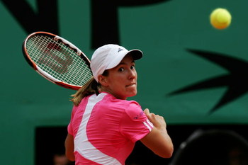 PARIS - JUNE 09:  Justine Henin of Belgium in action against Ana Ivanovic of Serbia during the Women's Singles Final on day fourteen of the French Open at Roland Garros on June 9, 2007 in Paris, France.  (Photo by Clive Rose/Getty Images)