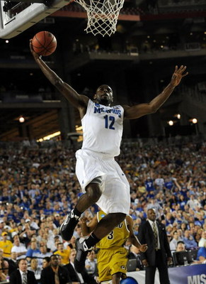GLENDALE, AZ - MARCH 26:  Guard Tyreke Evans #12 of the Memphis Tigers goes to dunk the ball against the Missouri Tigers in the Sweet 16 of the NCAA Division I Men's Basketball Tournament at the University of Phoenix Stadium on March 26, 2009 in Glendale,