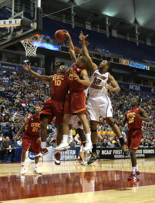 MINNEAPOLIS - MARCH 20:  DeMar DeRozan #10 and Daniel Hackett #13 of the USC Trojans fight for a rebound against Josh Southern #52 of the Boston College Eagles during the first round of the NCAA Division I Men's Basketball Tournament at the Hubert H. Hump