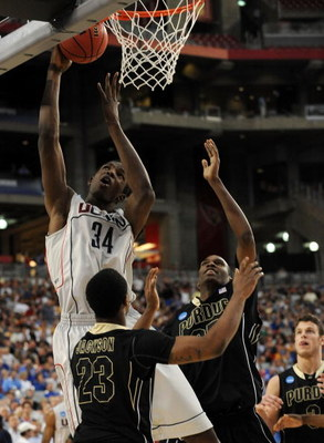 GLENDALE, AZ - MARCH 26:  Center Hasheem Thabeet #34 of the Connenticut Huskies goes up for a layup against the Purdue Boilermakers in the Sweet 16 of the NCAA Division I Men's Basketball Tournament at the University of Phoenix Stadium on March 26, 2009 i