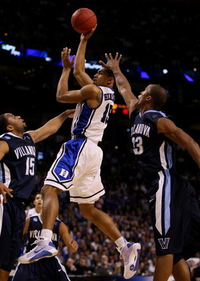 BOSTON - MARCH 26:  Gerald Henderson #15 of the Duke Blue Devils puts up a shot over Reggie Redding #15 and Dante Cunningham #33 of the Villanova Wildcats during the NCAA Men's Basketball Tournament East Regionals at TD Banknorth Garden on March 26, 2009