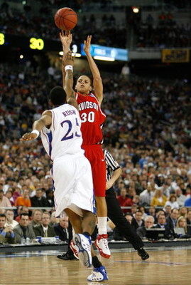DETROIT - MARCH 30:  Stephen Curry #30 of the Davidson Wildcats attempts a shot against Brandon Rush #25 of the Kansas Jayhawks during the Midwest Regional Final of the 2008 NCAA Division I Men's Basketball Tournament at Ford Field on March 30, 2008 in De