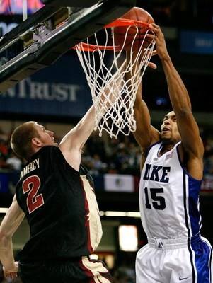 ATLANTA - MARCH 15:  Gerald Henderson #15 of the Duke Blue Devils draws a foul while dunking against Jordan DeMercy #2 of the Florida State Seminoles during the championship game of the 2009 ACC Men's Basketball Tournament at the Georgia Dome March 15, 20