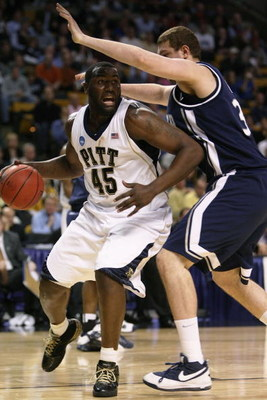BOSTON - MARCH 26:  DeJuan Blair #45 of the Pittsburgh Panthers tries to drive past Kenny Frease #32 of the Xavier Musketeers during the NCAA Men's Basketball Tournament East Regionals at TD Banknorth Garden on March 26, 2009 in Boston, Massachusetts.  (P