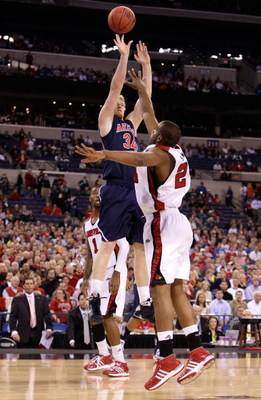 INDIANAPOLIS - MARCH 27:  Chase Budinger #34 of the Arizona Wildcats attempts a shot against Samardo Samuels #24 of the Louisville Cardinals during the third round of the NCAA Division I Men's Basketball Tournament at the Lucas Oil Stadium on March 27, 20