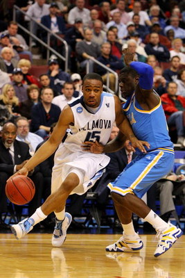 PHILADELPHIA - MARCH 21:  Reggie Redding #15 of the Villanova Wildcats drives against Jrue Holiday #21 of the UCLA Bruins during the second round of the NCAA Division I Men's Basketball Tournament at the Wachovia Center on March 21, 2009 in Philadelphia,