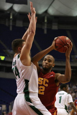 MINNEAPOLIS - MARCH 22:  Taj Gibson #22 of the USC Trojans drives against Goran Sutopn #14 of the Michigan State Spartans during the second round of the NCAA Division I Men's Basketball Tournament at the Hubert H. Humphrey Metrodome on March 22, 2009 in M