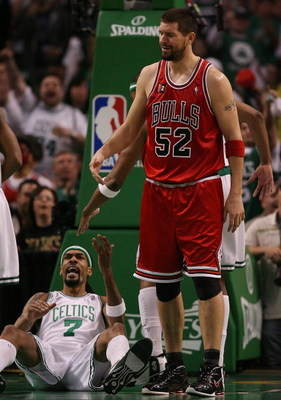 BOSTON - MAY 02:  Brad Miller #52 of the Chicago Bulls reacts after he is called for a foul as Mikki Moore #7 of the Boston Celtics celebrates in Game Seven of the Eastern Conference Quarterfinals during the 2009 NBA Playoffs at TD Banknorth Garden on May