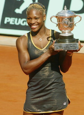 PARIS - JUNE 8: Serena Williams of the USA poses with the winner's cup after winning the French Open against her sister Venus on June 8, 2002 at the Roland Garros stadium in Paris, France. Serena deated Venus 7-5 6-3. (Photo by Pascal Le Segretain/Getty I